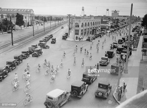 Pedallers APlenty Los Angeles California Auto traffic moves to one side as 300 girl bicycle riders swoop down a Los Angeles street during their...