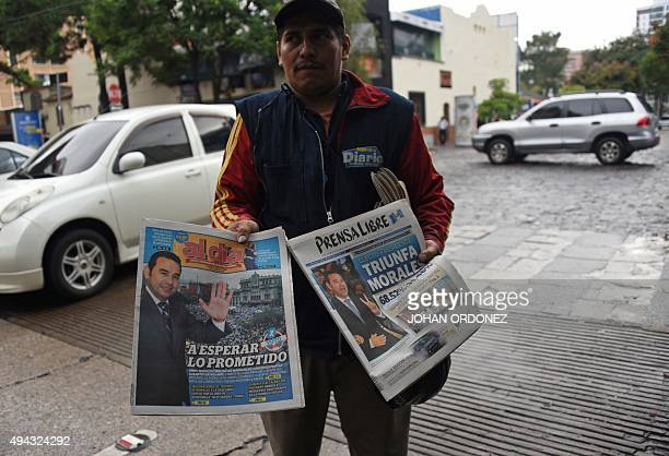A peddler offers newspapers in Guatemala City on October 26 the day after general elections Jimmy Morales a comic actor and TV personality declared...