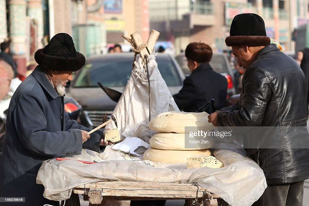 A peddler sales Uighur snack on the street in Kashgar, on December 10, 2012 in Kashi, China. Kashgar is home to the ethnic Uyghur Muslim community.