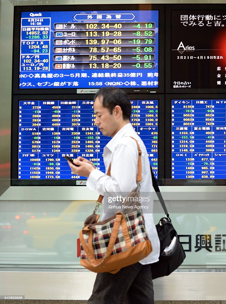 A pedestian walks in front of an electronic stock indicator in Tokyo, Japan, on June 24, 2016. The Japanese government on Friday expressed its concerns over a Britain's referendum result to leave the European Union, with rapid moves reflected the outcome affecting in both stocks and forex markets here. On Friday, Tokyo shares ended sharply lower with its benchmark Nikkei stock index losing nearly 8 percent on Brexit, marking the worst fall in over 16 years.