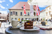 Enjoying a cup of coffee and a delicious cake in the pedestrian area in the city center of Moedling - Lower Austria
