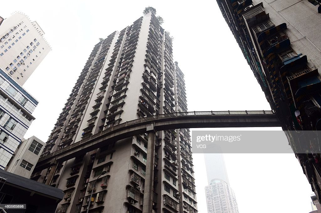 pedestrian bridge gets build at 13th floor in chongqing