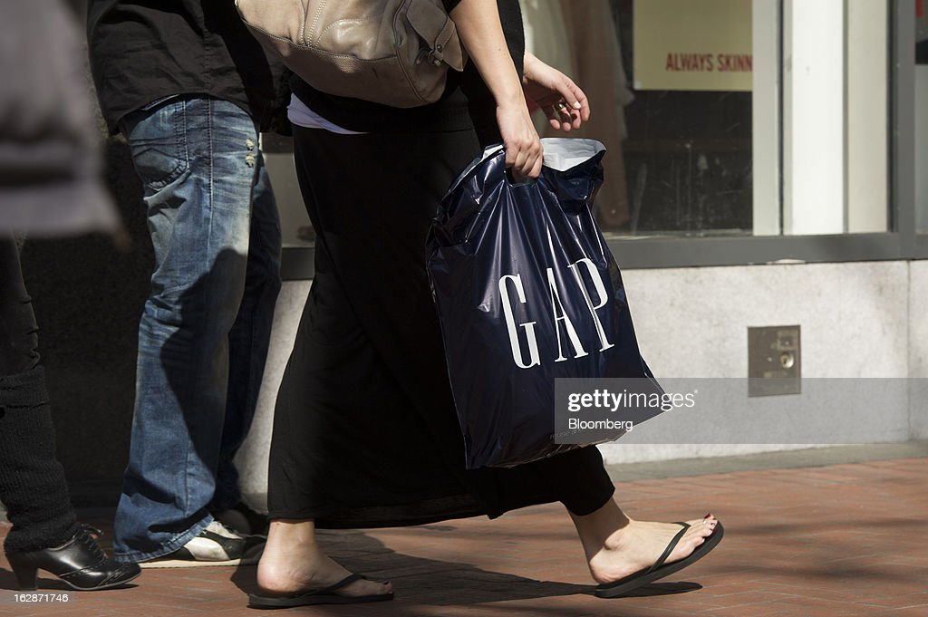 A pedestrian carries a Gap Inc. bag in San Francisco, California, U.S., on Thursday, Feb. 28, 2013. Gap Inc., the biggest U.S. specialty-apparel retailer, rose after posting fourth-quarter profit that topped analysts' estimates, fueled by its best holiday shopping season in six years. Photographer: David Paul Morris/Bloomberg via Getty Images