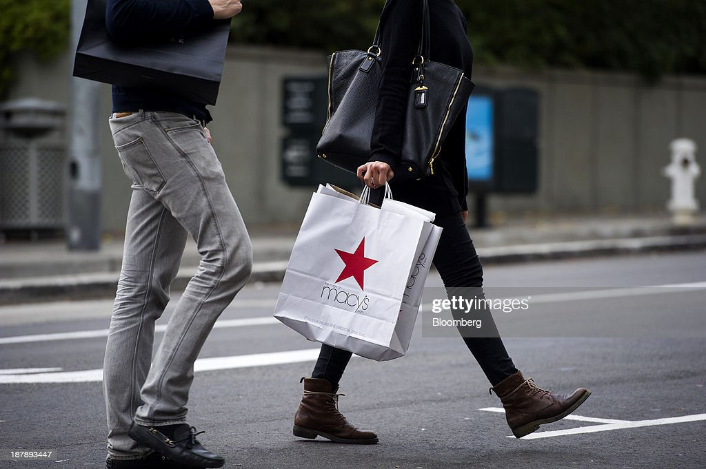 A pedestrian carries a Macy's Inc. shopping bag in San Francisco, California, U.S., on Monday, Nov. 11, 2013. The Bloomberg Consumer Comfort Index is scheduled to be released on Nov. 14. Photographer: David Paul Morris/Bloomberg via Getty Images