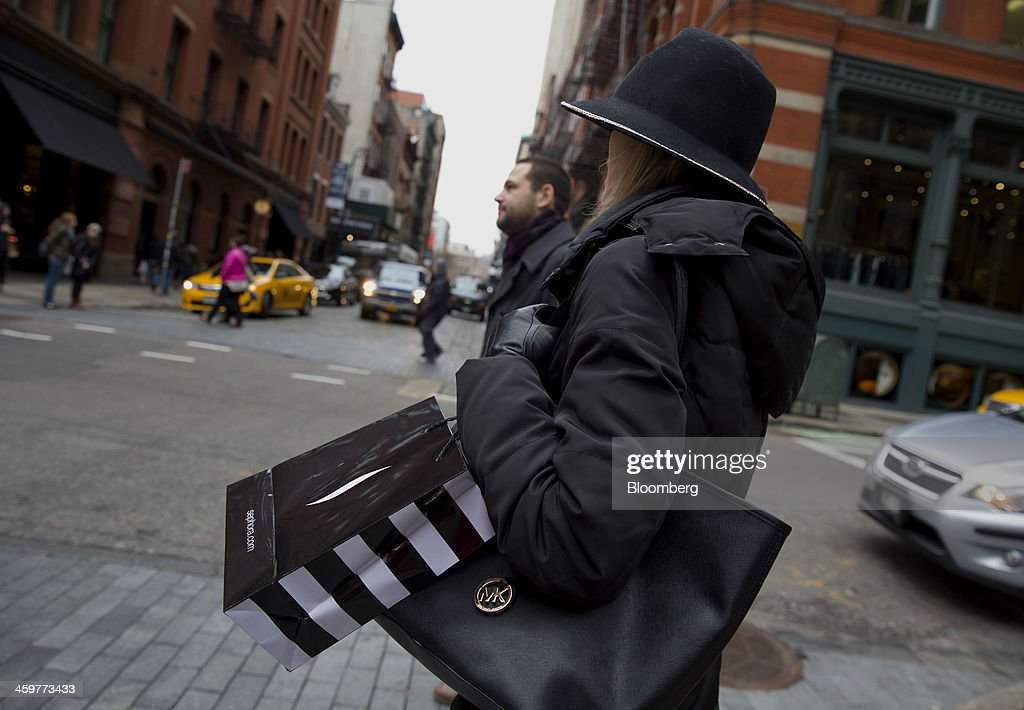 A pedestrian carries a Sephora USA Inc. shopping bag while walking in the Soho neighborhood of New York, U.S., on Monday, Dec. 30, 2013. The failure of United Parcel Service Inc. (UPS) and FedEx Corp. to deliver packages in time for Christmas has exposed the perils of retailers promising to get last-minute gifts to customers. Photographer: Jin Lee/Bloomberg via Getty Images