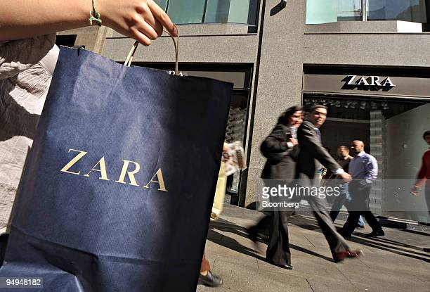A pedestrian carries a Zara shopping bag in Madrid Spain on Tuesday March 24 2009 Inditex SA Europe's largest clothing retailer reported the steepest...