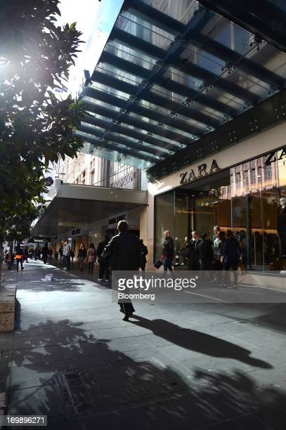 A pedestrian casts a shadow while walking past a Zara fashion store operated by Inditex SA on Bourke Street Mall in central Melbourne Australia on...