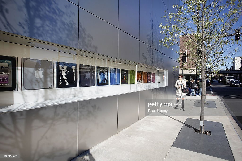 A pedestrian checks out an exterior display at the new Apple Store featuring various Apple products on October 21, 2010 in Chicago, Illinois. The new store opens on October 23 in Lincoln Park, a part of the city's Near North Side that has been trendy for several years.