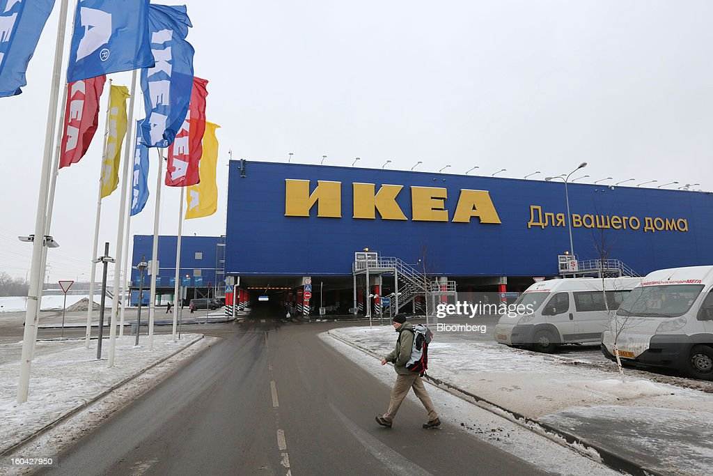 A pedestrian crosses a parking lot outside the Ikea Group store at the MEGA Belaya Dacha shopping complex, constructed by the real estate development arm of Inter Ikea Systems BV and one of Europe's largest malls, in Moscow, Russia, on Thursday, Jan. 31, 2013. Russian shopping-mall construction may climb to a record this year as retailers take advantage of rising sales by moving into bigger, more modern buildings, Cushman & Wakefield Inc. said. Photographer: Andrey Rudakov/Bloomberg via Getty Images