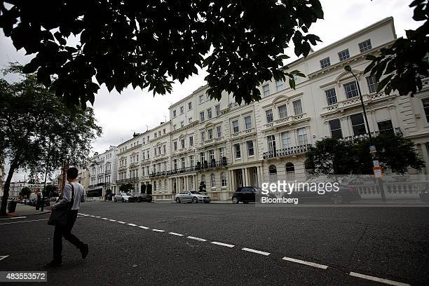 A pedestrian crosses a street in the Kensington and Chelsea district of London UK on Monday Aug 10 2015 Buytolet loans have made up most of the...