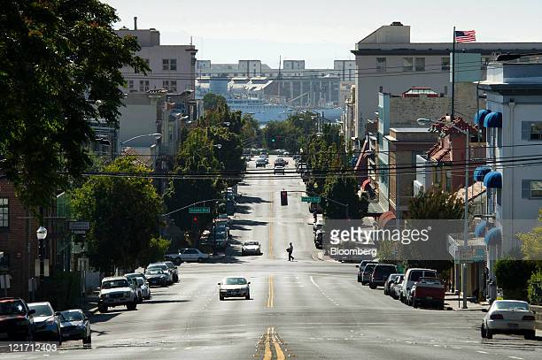 A pedestrian crosses Georgia Street in Vallejo California US on Friday Aug 19 2011 Vallejo located 24 miles north of San Francisco emerged from...
