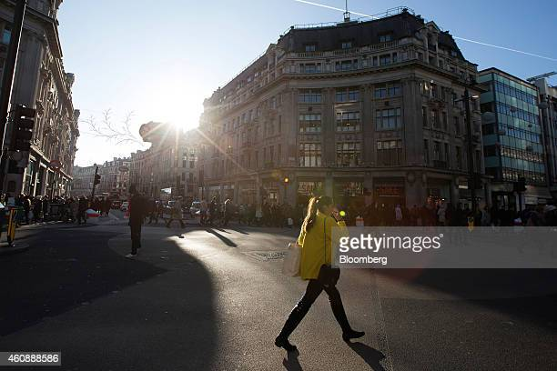 A pedestrian crosses the intersection between Oxford Street and Regent Street in London UK on Monday Dec 29 2014 The UK may overtake France this year...