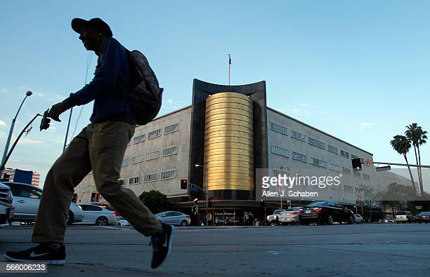A pedestrian crosses the street near the May Co building at the intersection of Wilshire Blvd and Fairfax Ave in Los Angeles Thursday April 11 2013 A...