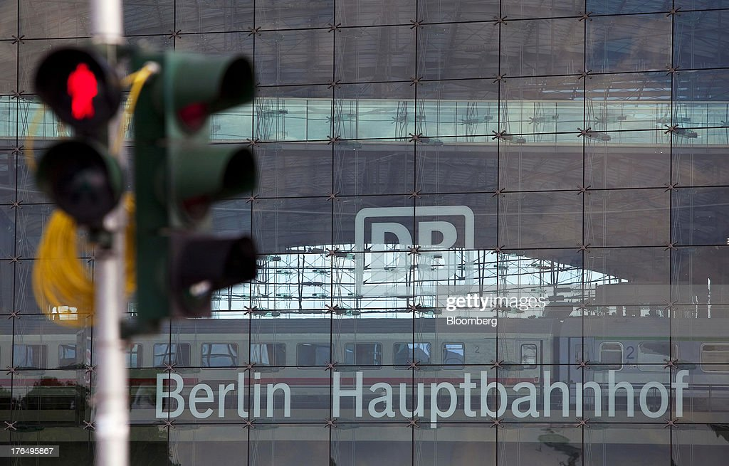 Pedestrian crossing lights stand illuminated in front of Berlin Central Station, also known as Hauptbahnhof, in Berlin, Germany, on Tuesday, Aug. 13, 2013. German gross domestic product rose 0.7 percent from the first quarter and the French economy expanded 0.5 percent, the countries' national statistics offices said today. Photographer: Krisztian Bocsi/Bloomberg via Getty Images