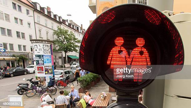 A pedestrian crossing signal showing a female homosexual couple at a junction on July 14 2015 in Munich Germany The city taking a cue from a similar...