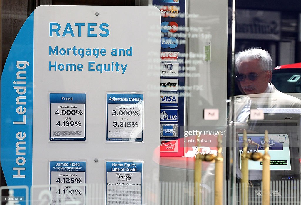 A pedestrian is reflected in a window as he walks by a sign displaying mortgage rates inside a Citibank office on June 7, 2012 in San Francisco, California. Average rates for 30 and 15 year fixed mortgages fell for the sixth straight week to record lows. The 30 year loan fell to 3.67 percent from 3.75 percent last week and the 15 year mortgage dropped to 2.94 percent compared 2.97 percent one week ago.