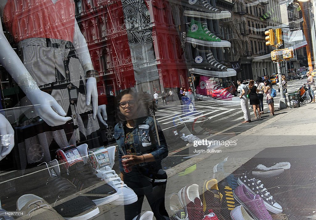 A pedestrian is seen reflected in the window of a shoe store on April 16, 2012 in New York City. Despite high energy prices, the Commerce Department reported today that retail sales beat expectations in March with an 0.8 percent rise compared to a 1.0 percent increase in February.