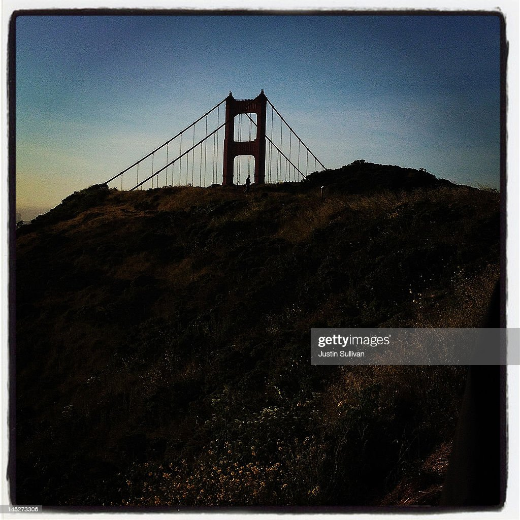 A pedestrian is seen silhouetted while walking by the Golden Gate Bridge on May 1, 2012 in Sausalito, California. The Golden Gate Bridge, Highway and Transportation District is preparing for the 75th anniversary of the iconic Golden Gate Bridge that will be marked with a festival on May 26 - 27 that will feature music, displays of bridge artifacts and art exhibits. The 1.7 mile steel suspension bridge, one of the modern Wonders of the World, opened to traffic on May 27, 1937.