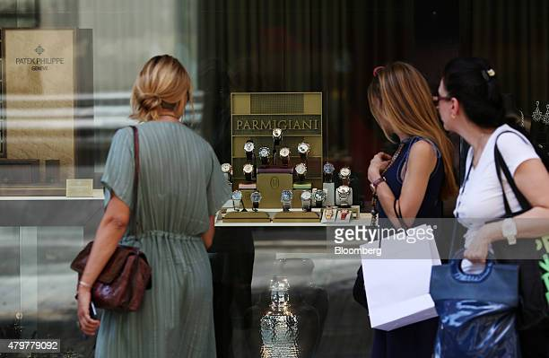 Pedestrian look at a display of Parmigiani Fleurier SA wristwatches displayed in the window of a luxury watch store in Athens Greece on Tuesday July...
