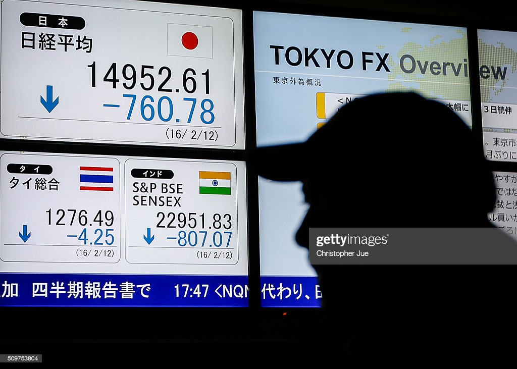 A pedestrian looks at a stock market indicator board on February 12, 2016 in Tokyo, Japan. The Nikkei Stock Average finished 11% down for the week, its biggest weekly drop since October 2008, and the index for the day ended 4.8% down, the lowest since October 2014.
