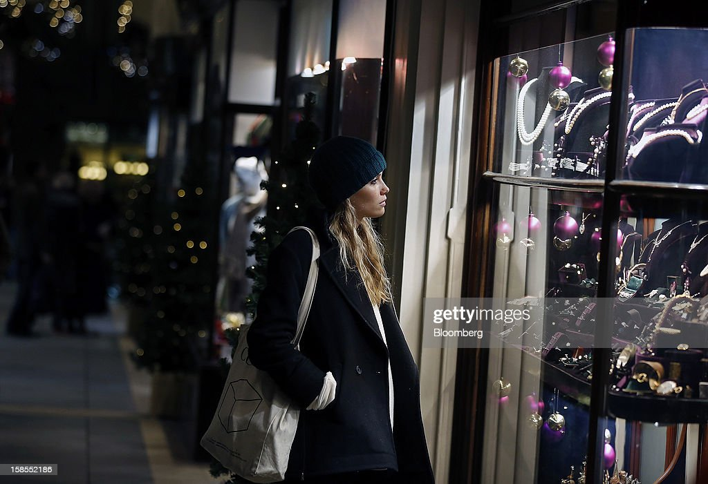 A pedestrian looks at jewelry in the Christmas window display of jewller's store in Burlington Arcade in London, U.K., on Monday, Dec. 17, 2012. Retailers are relying on Christmas sales to help rescue a year when high unemployment and the debt crisis have blighted spending. Photographer: Simon Dawson/Bloomberg via Getty Images