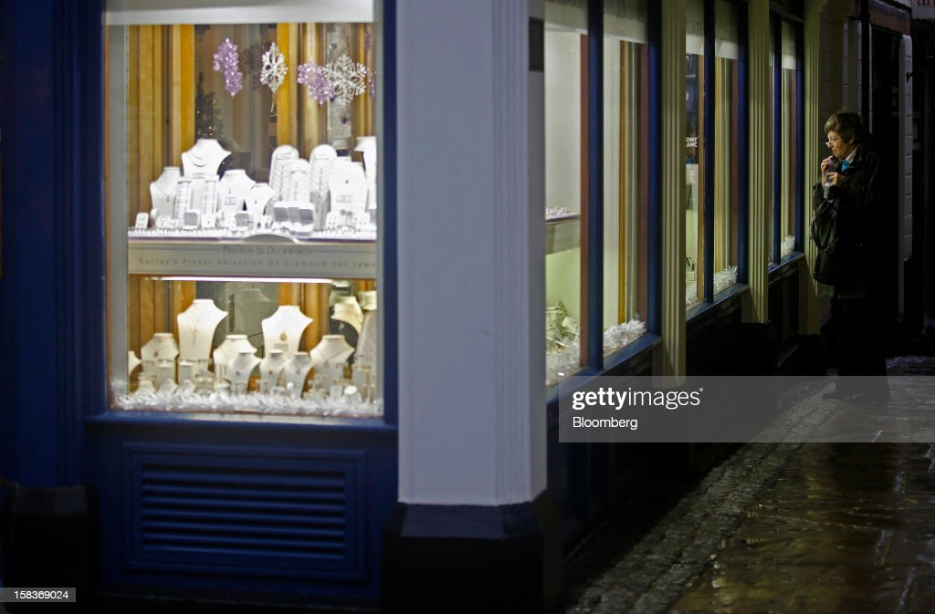 A pedestrian looks at the window display of a jeweler's store in Guildford, U.K., on Friday, Dec. 14, 2012. Standard & Poor's lowered its outlook on Britain's top credit rating to negative, citing weak economic growth and a worsening debt profile. Photographer: Simon Dawson/Bloomberg via Getty Images
