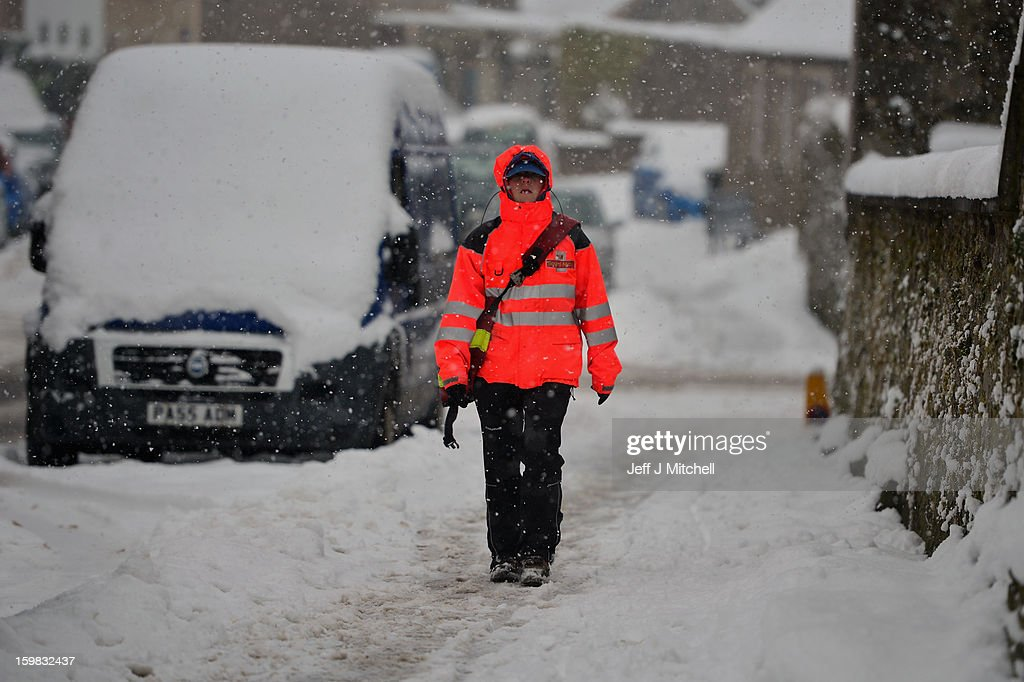 A pedestrian makes her way through the snow on January 21, 2012 in Lauder, Scotland. Widespread snowfall is affecting most of the UK with school closures and transport disruption. The Met Office has issued a red weather warning for parts of Wales, advising against all non-essential travel as up to 30cm of snow is expected to fall in some areas today.