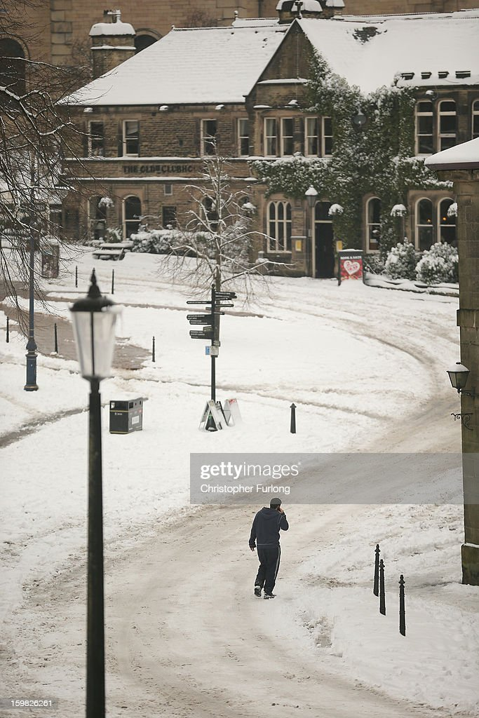 A pedestrian makes his way through a snow covered Buxton on January 21, 2013 in Buxton, United Kingdom. The Met Office has issued a red weather warning for parts of the Uk and advising against all non-essential travel as up to 30cm of snow is expected to fall in some areas today. The adverse weather has closed nearly 5,000 schools and caused many airports to cancel flights.