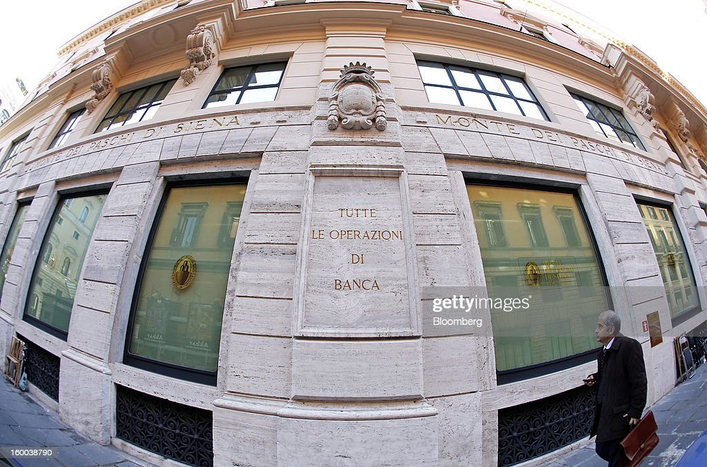 A pedestrian passes a Banca Monte dei Paschi di Siena SpA bank branch in Rome, Italy, on Friday, Jan. 25, 2013. Italian Prime Minister Mario Monti said the Bank of Italy will take another look at Banca Monte dei Paschi di Siena SpA's books after the company disclosed this week it may face more than 700 million euros of losses related to structured finance transactions hidden from regulators. Photographer: Alessia Pierdomenico/Bloomberg via Getty Images
