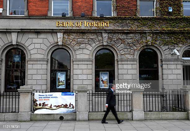 A pedestrian passes a Bank of Ireland branch in Dublin Ireland on Thursday April 14 2011 Bank of Ireland Plc said it will outline plans to raise 52...
