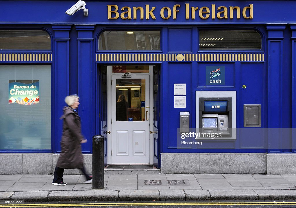 A pedestrian passes a Bank of Ireland Plc branch in Dublin, Ireland, on Friday, Dec. 28, 2012. Ireland will take over the EU presidency in January as the euro-area wrestles with putting the European Central Bank in charge of lenders within the currency union and other participating nations. Photographer: Aidan Crawley/Bloomberg via Getty Images
