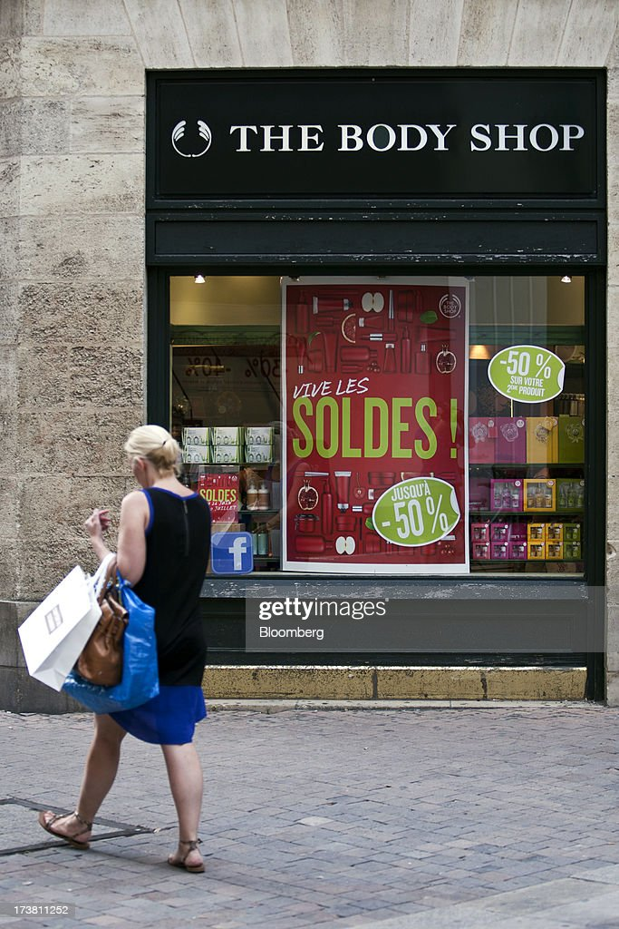 A pedestrian passes a Body Shop store, owned by L'Oreal SA, in Bordeaux, France, on Wednesday, July 17, 2013. Austerity measures and rising unemployment are restraining consumer spending in Europe, while retailers including Groupe Auchan SA and Casino Guichard-Perrachon SA are competing more aggressively on price. Photographer: Balint Porneczi/Bloomberg via Getty Images