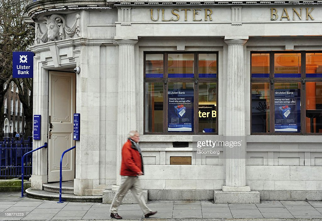 A pedestrian passes a branch of Ulster Bank Ltd., the Irish unit of Royal Bank of Scotland Group Plc, in Dublin, Ireland, on Friday, Dec. 28, 2012. Ireland will take over the EU presidency in January as the euro-area wrestles with putting the European Central Bank in charge of lenders within the currency union and other participating nations. Photographer: Aidan Crawley/Bloomberg via Getty Images