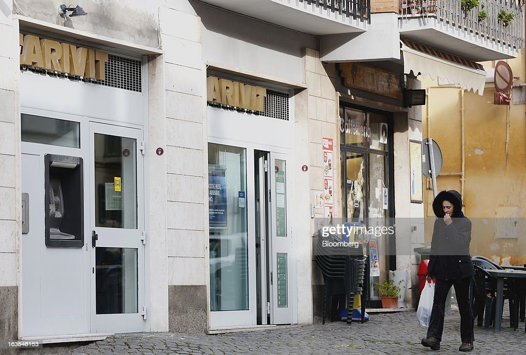 A pedestrian passes a Cassa Di Risparmio Della Provincia Di Viterbo SpA bank branch, a subsidiary of Intesa Sanpaolo SpA, in Vetralla, Italy, on Monday, March 11, 2013. Intesa Sanpaolo SpA and UniCredit SpA are among Italian banks due to report losses for the fourth quarter this week, as the economic contraction meant more clients failed to repay their debts. Photographer: Alessia Pierdomenico/Bloomberg via Getty Images