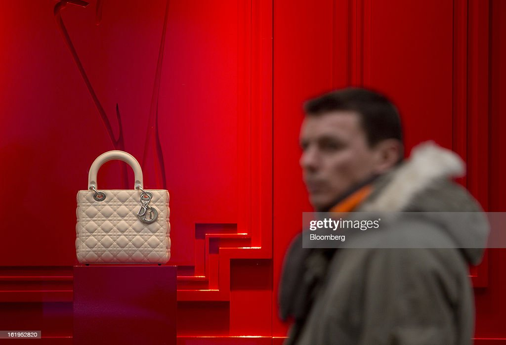 A pedestrian passes a Christian Dior SA handbag displayed in the window of a Dior store in central Prague, Czech Republic, on Sunday, Feb. 17, 2013. Worsened outlook for Czech economy is in line with the government's expectations and lower-than-planned tax revenue is 'manageable' under 2013 budget, Prime Minister Petr Necas said on Czech public television. Photographer: Martin Divisek/Bloomberg via Getty Images