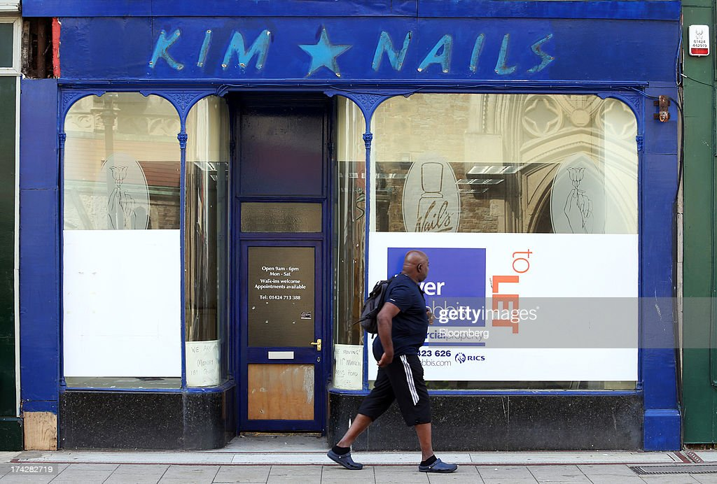 A pedestrian passes a closed down beauty parlour in Hastings, U.K., on Tuesday, July 23, 2013. U.K. retail sales rose for a second month in June as discounts at department stores drove demand for clothes and electrical products. Photographer: Chris Ratcliffe/Bloomberg via Getty Images