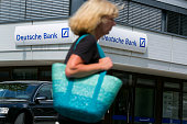 A pedestrian passes a Deutsche Bank AG branch in Boblingen Germany on Monday July 25 2016 Deutsche Bank Chief Executive Officer John Cryan will try...