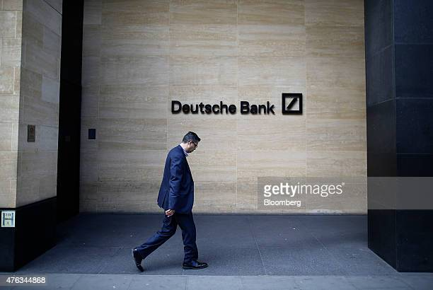 A pedestrian passes a Deutsche Bank logo outside the offices of Deutsche Bank AG in London UK on Monday June 8 2015 John Cryan a supervisory board...