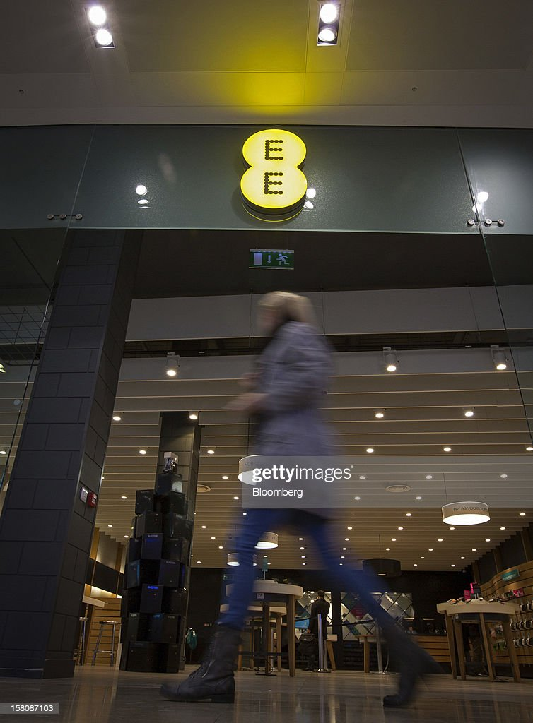 A pedestrian passes a EE (Everything Everywhere) store, a joint venture between France Telecom SA and Deutsche Telekom AG, in Stratford, U.K., on Monday, Dec. 5, 2012. France Telecom CEO Stephane Richard said in an interview last month that the Paris-based company has received interest from private-equity firms seeking a minority stake in the 50-50 venture, and may also consider an initial public offering of the unit. Photographer: Jason Alden/Bloomberg via Getty Images