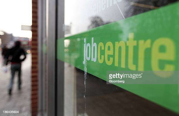 A pedestrian passes a job centre in London UK on Wednesday Jan 4 2012 Britain pledged 1 billion pounds to tackle youth unemployment after the number...