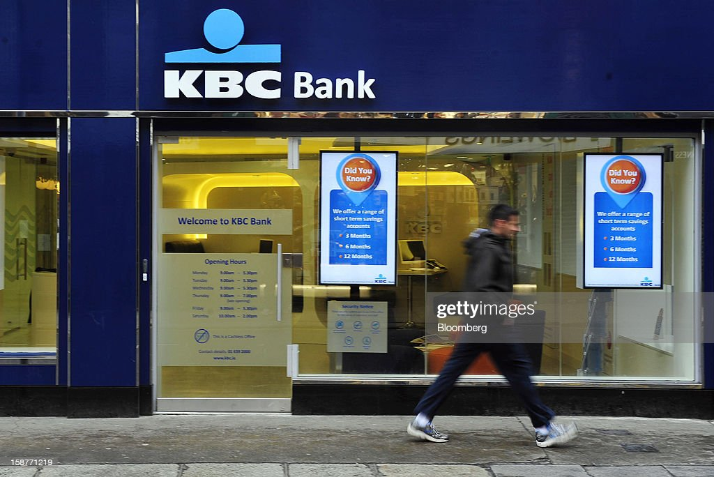 A pedestrian passes a KBC Bank branch, operated by KBC Groep NV, in Dublin, Ireland, on Friday, Dec. 28, 2012. Ireland will take over the EU presidency in January as the euro-area wrestles with putting the European Central Bank in charge of lenders within the currency union and other participating nations. Photographer: Aidan Crawley/Bloomberg via Getty Images