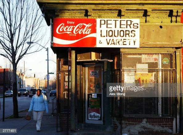 A pedestrian passes a liquor store in the Middle East neighborhood three blocks north of Johns Hopkins University Medical School December 2 2003 in...