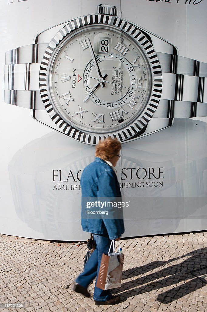 A pedestrian passes a luxury watch billboard outside a new flagship store due to open for the Rolex Group in Lisbon, Portugal, on Tuesday, Nov. 12, 2013. Portugal's jobless rate dropped for a second quarter, falling to 15.6 percent in the three months through September as the country's economy shows signs of recovery. Mario Proenca/Bloomberg via Getty Images