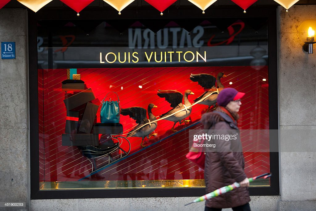 A pedestrian passes a LVMH Moet Hennessy Louis Vuitton SA luxury retail store in Munich, Germany, on Sunday, Nov. 24, 2013. In Germany, Europe's biggest economy, annual consumer prices increased 1.2 percent in October. Photographer: Krisztian Bocsi/Bloomberg via Getty Images