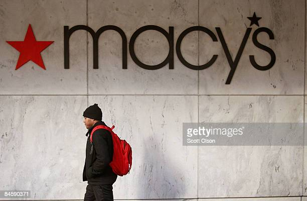 A pedestrian passes a Macy's store along the Magnificent Mile February 2 2009 in Chicago Illinois Today Macy's Inc announced that it will cut nearly...