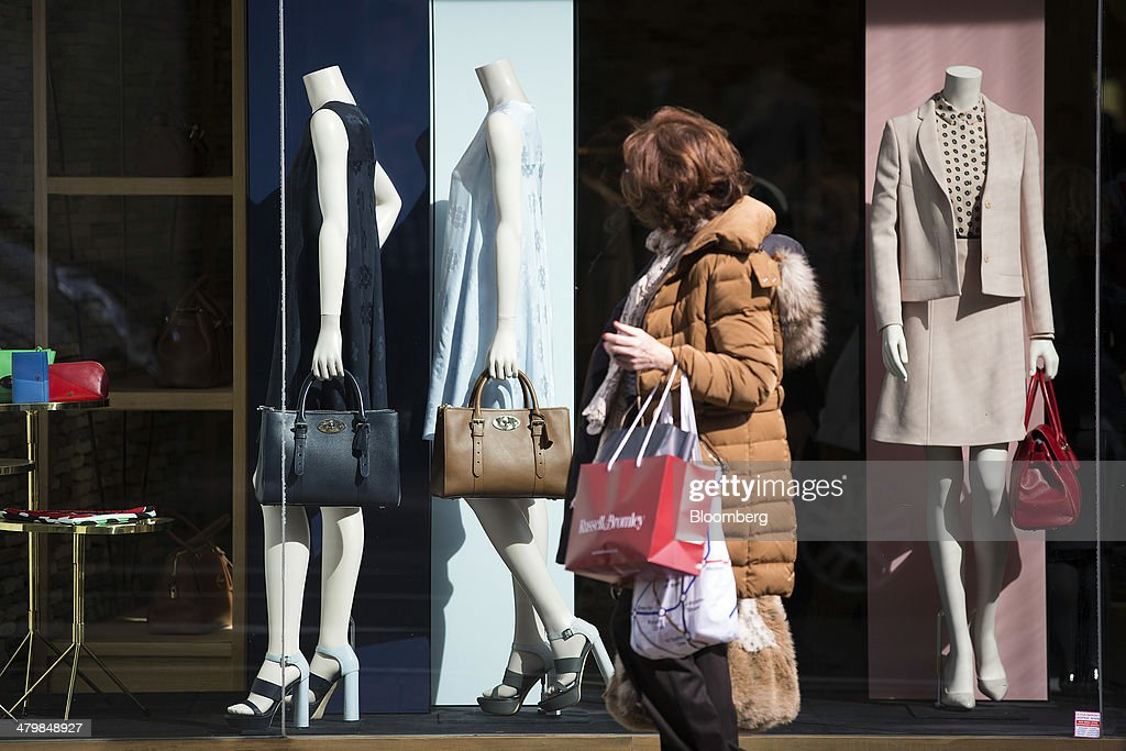 A pedestrian passes a Mulberry Group Plc luxury store on New Bond Street in London, U.K., on Thursday, March 20, 2014. Mulberry Group said Bruno Guillon will step down as chief executive officer after two years during which the British luxury handbag maker lost two-thirds of its market value. Photographer: Simon Dawson/Bloomberg via Getty Images