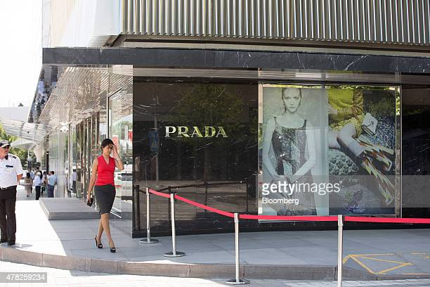 A pedestrian passes a security cordon outside the Prada SpA fashion store at the Esentai luxury shopping mall in Almaty Kazakhstan on Tuesday June 23...