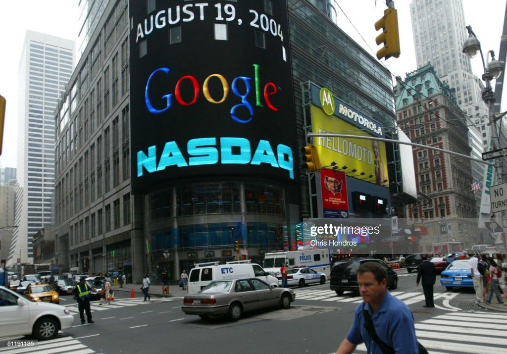 A pedestrian passes a sign marking Google being traded on the NASDAQ Marketsite August 19, 2004 in New York City. Shares of Google Inc. were expected to begin trading publicly on the Nasdaq Stock Market August 19, at a lower per share price than anticipated.