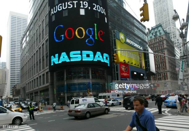 A pedestrian passes a sign marking Google being traded on the NASDAQ Marketsite August 19 2004 in New York City Shares of Google Inc were expected to...