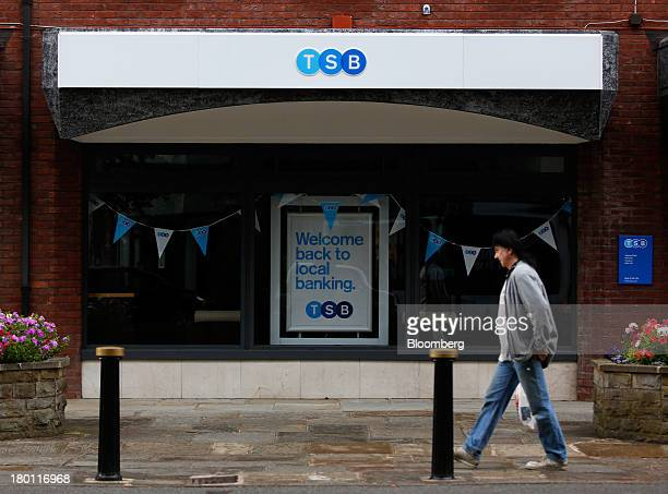 A pedestrian passes a TSB bank branch part of the Lloyds Banking Group Plc ahead of the official rebranding in Wilmslow UK on Sunday Sept 8 2013 The...